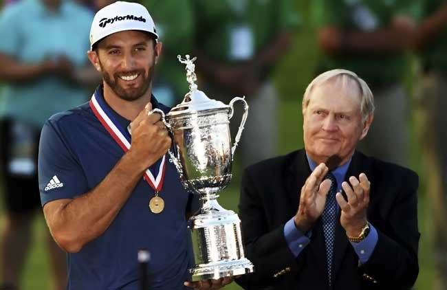 OAKMONT, PA - JUNE 19:  Dustin Johnson of the United States celebrates with the winner's trophy alongside Jack Nicklaus after winning the U.S. Open at Oakmont Country Club on June 19, 2016 in Oakmont, Pennsylvania.  (Photo by Ross Kinnaird/Getty Images)