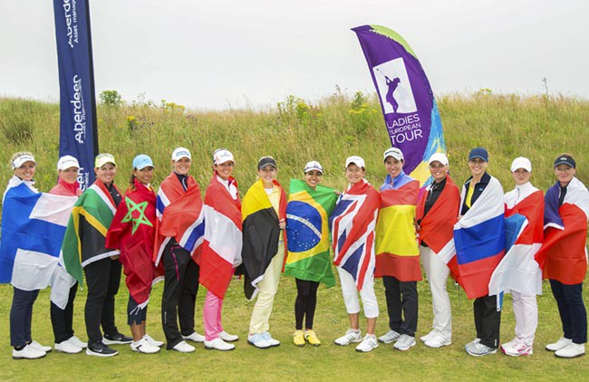 22/07/2016. Ladies European Tour 2016. Aberdeen Asset Management Ladies Scottish Open, Dundonald Links, Irvine, Scotland. 22-34 August. Future Olympic golfers competing in the Aberdeen Asset Management Ladies Scottish Open pose with their national flags after the first round at Dundonald Links. Credit: Tristan Jones